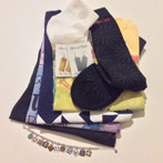 Artfully arranged stack of socks and shirts