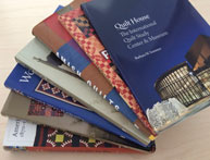 Artfully arranged stack of quilt related books