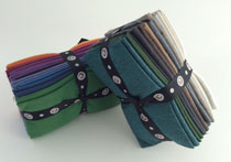 Two bundles of quilting fat quarters